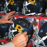 A close up of Joe Montana signing for National Sports Distributors