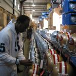 Jerry Rice autographing 49er and Raider helmets for National Sports Distributors