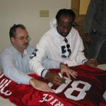Jerry Rice autographing jerseys for National Sports Distributors
