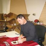 Steve Young signing jerseys for National Sports Distributors