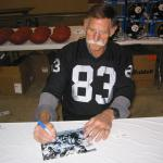 Ben Davidson autographing 8x10 photos for National Sports Distributors