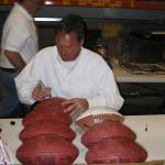 Dwight Clark autographing footballs at National Sports Distributors