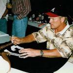 Terry Bradshaw autographs jerseys for National Sports Distributors