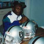 Oakland Raiders Tim Brown autographing for National Sports Distributors