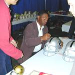 Marcus Allen autographing helmets for National Sports Distributors