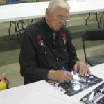 Chuck Bednarik signing photos for National Sports Distributors