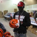 Chad Johnson autographing helmets for National Sports Distributors