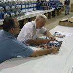 George Blanda signing photos with Robert Hemphill of National Sports Distributors