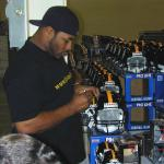 Jerome Bettis autographing helmets for National Sports Distributors