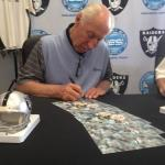 Fred Biletnikoff autographing photos for NSD