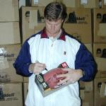 Brad Johnson sutographing footballs for National Sports Distributors