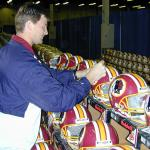 Brad Johnson autographing helmets for National Sports Distributors