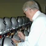George Blanda autographing helmets for National Sports Distributors