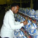 Barry Sanders autographing helmets for National Sports Distributors