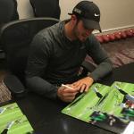 Derek Carr signing photos for NSD