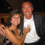 Dwight Clark and Joan Hemphill admiring his 5 Super Bowl rings at appearance dinner