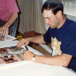 Will Clark autographing photos at his home for National Sports Distributors