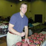 Tim Couch autographing footballs for National Sports Distributors