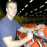 Tim Couch autographing helmets for National Sports Distributors