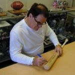Pete Rose autographing bats for National Sports Distributors