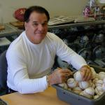 Pete Rose autographing baseballs for National Sports Distributors