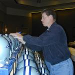Troy Aikman autographs Dallas Cowboys helmets for National Sports Distributors