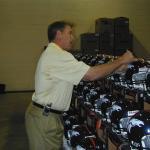 John Elway autographing helmets for National Sports Distributors