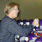 Fran Tarkenton signing helmets for National Sports Distributors
