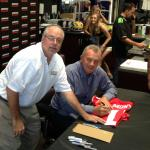 NSD President Rob Hemphill and Joe Montana working together at a Kawasaki Dealership
