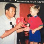 "Muhammad Ali ""boxing"" with owner's son"
