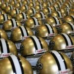 Cool shot of Saints helmets set up for signing