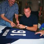 Joe Montana autographing Pro Bowl Jerseys for National Sports Distributors