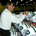 Joe Namath autographing helmets for National Sports Distributors