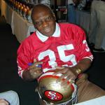 John Henry Johnson autographing helmets for National Sports Distributors