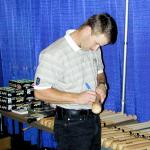 Jeff Kent signing bats for National Sports Distributors