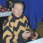 Len Dawson autographing Throwback Duke Footballs for National Sports Distributors