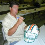 Dan Marino autographing helmets for National Sports Distributors