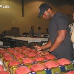 Curtis Martin autographing footballs for National Sports Distributors