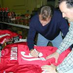 Joe Montana autographing jerseys for National Sports Distributors