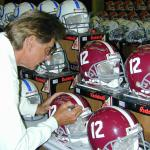 Joe Namath signing helmets for National Sports Distributors