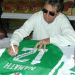 Joe Namath autographing jerseys for National Sports Distributors
