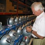 The Snake Ken Stabler autographing Raider Helmets for National Sports Distributors