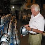 Ken Stabler autographing helmets at National Sports Distributors