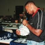 Darren Woodson autographing for National Sports Distributors