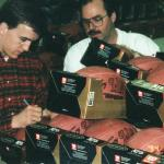 Peyton Manning autographing footballs for National Sports Distributors