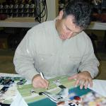 Rich Gannon autographing 16x20 photos for National Sports Distributors