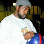 Ron Dayne autographing helmets for National Sports Distributors