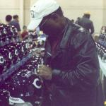 Gale Sayers signing helmets for National Sports Distributors