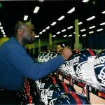 Lawrence Taylor signing helmets for NSD