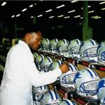 Barry Sanders signing helmets for National Sports Distributors